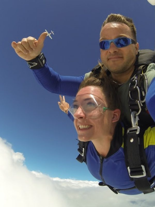 man-and-woman-in-blue-jacket-doing-sky-diving-739671